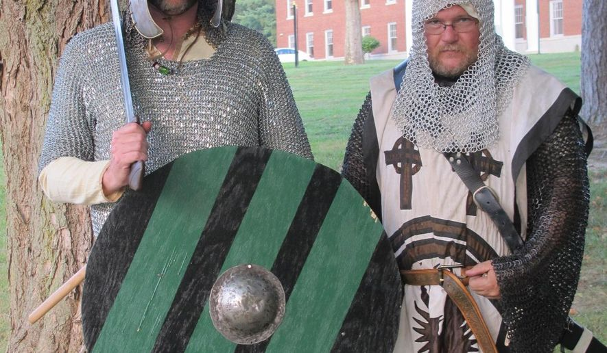 ADVANCE FOR SUNDAY SEPT. 20 -This Thursday Sept 3, 2015 photo shows medieval re-enactors Darrin Cox, left, and, Russ Schultz at a medieval weapons demonstration on the campus of West Liberty University in Wheeling, W,Va.  (Alan Olson/The Intelligencer via AP) MANDATORY CREDIT