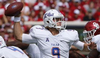 Tulsa quarterback Dane Evans (9) passes against Oklahoma during the first quarter of an NCAA college football game in Norman, Okla., Saturday, Sept. 19, 2015. (AP Photo/Alonzo Adams)