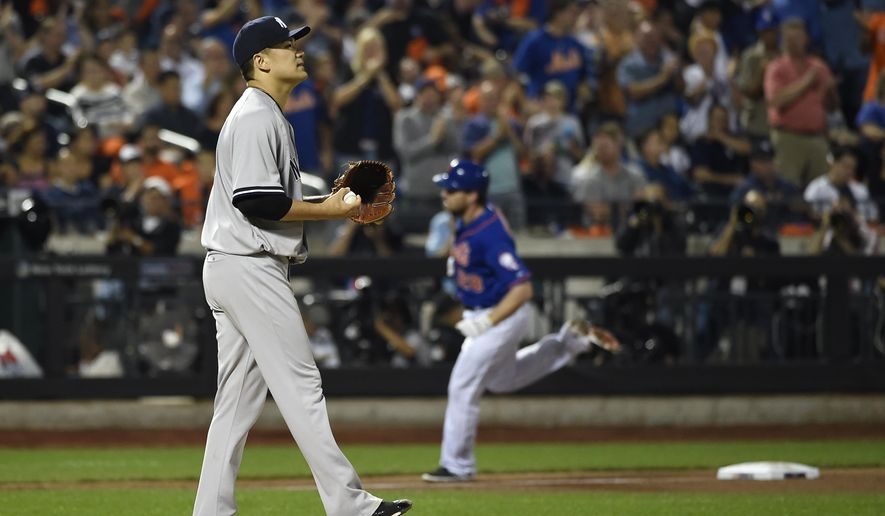 New York Yankees starting pitcher Masahiro Tanaka reacts on the mound as New York Mets' Daniel Murphy (28) rounds third base after hitting a solo home run in the sixth inning of a baseball game, Friday, Sept. 18, 2015, in New York. (AP Photo/Kathy Kmonicek)