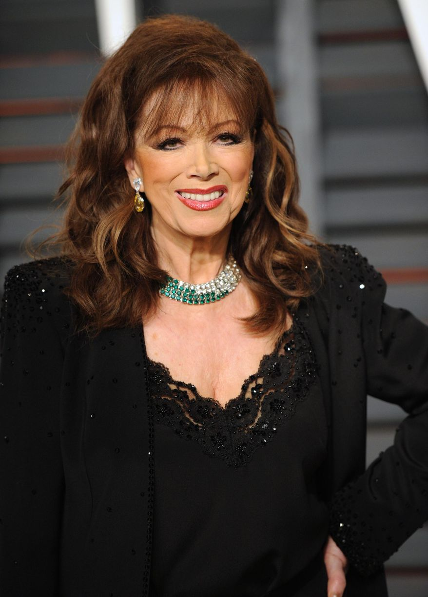 FILE - In this Feb. 22, 2015 file photo, author Jackie Collins arrives at the 2015 Vanity Fair Oscar Party n Beverly Hills, Calif. Collins, died of breast cancer in Los Angeles on Saturday, Sept. 19, 2015. She was 77. (Photo by Evan Agostini/Invision/AP, FIle)