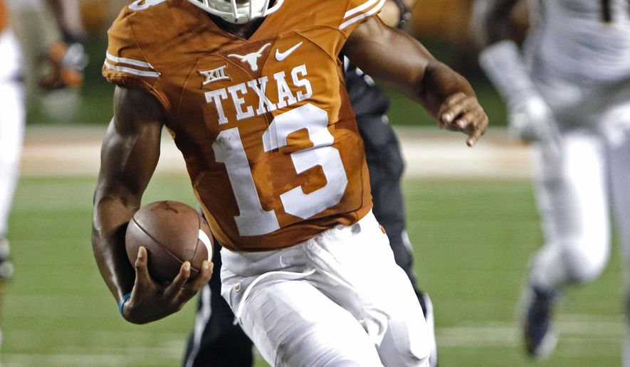 Texas quarterback Jerrod Heard (13) runs for a touchdown during the second half of an NCAA college football game against California, Saturday, Sept. 19, 2015, in Austin, Texas. (AP Photo/Michael Thomas)
