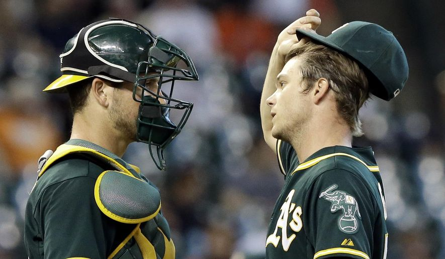 Oakland Athletics catcher Carson Blair, left, talks with starting pitcher Sonny Gray in the first inning of a baseball game against the Houston Astros, Saturday, Sept. 19, 2015, in Houston. (AP Photo/Pat Sullivan)