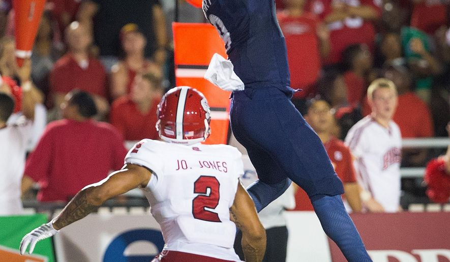 Old Dominion wide receiver Jonathan Duhart catches a touchdown pass over North Carolina State safety Josh Jones during an NCAA college football game Saturday, Sept. 19, 2015, in Norfolk, Va. (Hyunsoo Leo Kim/The Virginian-Pilot via AP)