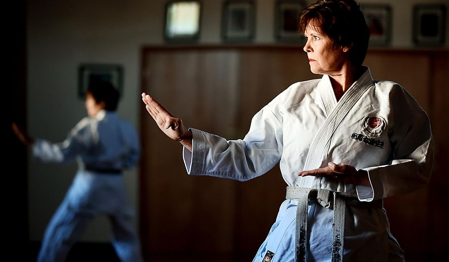 Tina Malkuch, of the International Shotokan Karate Federation of Montana, poses for a photo in the dojo, on Friday, Sept. 11, 2015 in Kalispell, Mont. (Brenda Ahearn/Daily Inter Lake via AP)