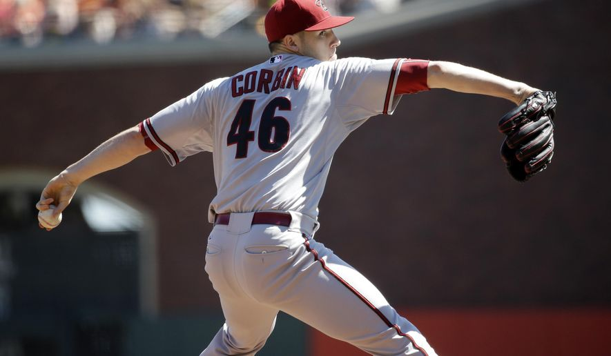 Arizona Diamondbacks starting pitcher Patrick Corbin throws to the San Francisco Giants during the first inning of a baseball game on Saturday, Sept. 19, 2015, in San Francisco. (AP Photo/Marcio Jose Sanchez)