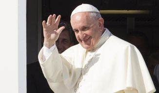 Pope Francis waves to reporters at Rome's Fiumicino international airport, Saturday, Sept. 19, 2015, as he boards his flight to La Habana, Cuba, where he will start a 10-day trip including the United States. (AP Photo/Riccardo De Luca)