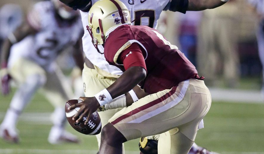 Florida State defensive tackle Nile Lawrence-Stample tracks down Boston College quarterback Darius Wade on a sack during the second half of an NCAA college football game in Boston, Friday, Sept. 18, 2015. (AP Photo/Charles Krupa)