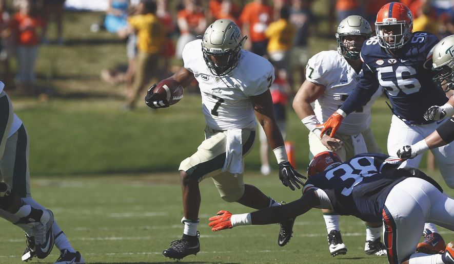 William & Mary running back Mikal Abdul-Saboor (7) rushes past Virginia strong safety Kelvin Rainey (38) during the first half of an NCAA college football game on Saturday, Sept. 19, 2015 in Charlottesville, Va. (Ryan. M. Kelly//The Daily Progress via AP) MANDATORY CREDIT