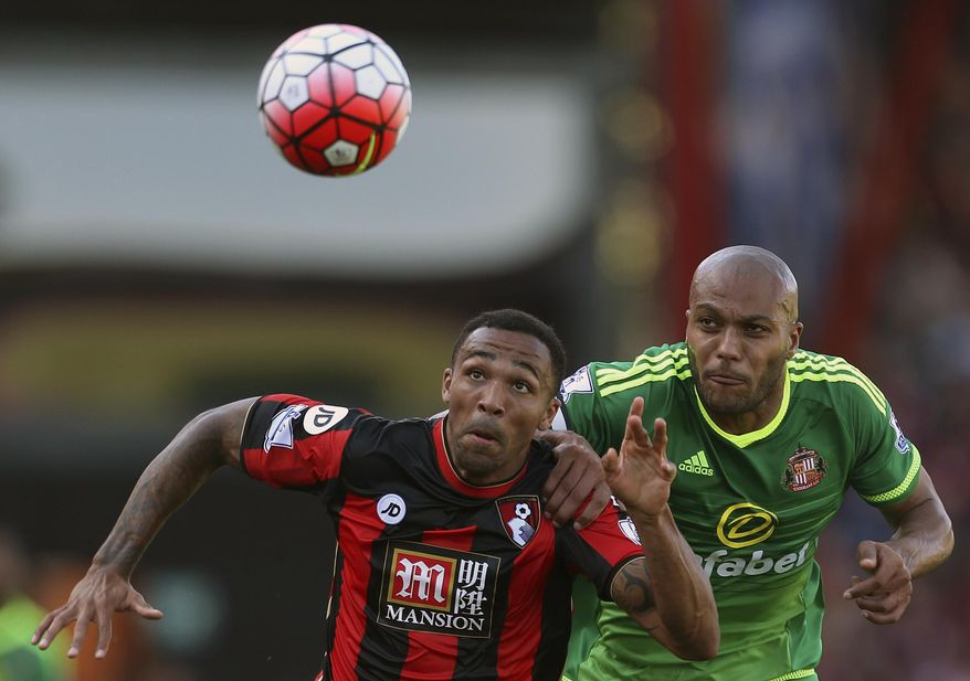 Bournemouth's Callum Wilson, left,  and Sunderland's Younes Kaboul battle for the ball during their English  Premier League soccer match at the Vitality Stadium, Bournemouth England Saturday Sept. 19, 2015. (Steve Paston/PA via AP) UNITED KINGDOM OUT