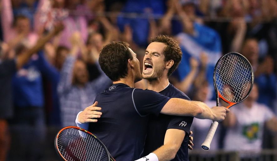 Britain's Andy Murray, right, and Jamie Murray, left, celebrate after winning against Australia's Sam Groth and Lleyton Hewitt at the end of the semifinal doubles tennis match between Britain and Australia of the Davis Cup in Glasgow, Scotland Saturday Sept. 19, 2015. (AP Photo/Scott Heppell)