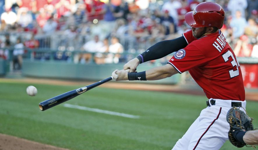 Washington Nationals' Bryce Harper hits a sacrifice fly to score Jordan Zimmermann during the fifth inning of a baseball game against the Miami Marlins at Nationals Park, Saturday, Sept. 19, 2015, in Washington. (AP Photo/Alex Brandon)