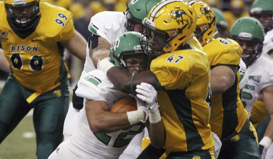 North Dakota State defender Pierre Gee-Tucker (47) stops North Dakota running back John Santiago during the first half of an NCAA college football game Saturday, Sept. 19, 2015, in Fargo, N.D. (AP Photo/Bruce Crummy)