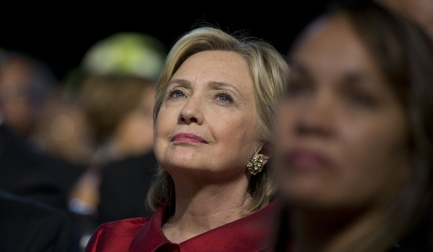 Democratic presidential candidate Hillary Rodham Clinton looks to President Barack Obama as he speaks on stage at the Congressional Black Caucus Foundation's 45th Annual Legislative Conference Phoenix Awards Dinner at the Walter E. Washington Convention Center in Washington, Saturday, Sept. 19, 2015. The president spoke about black women's role in helping shape American democracy. (AP Photo/Carolyn Kaster)
