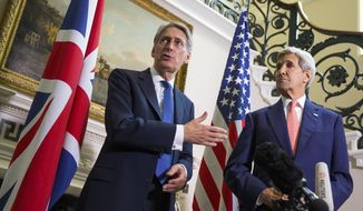 British Foreign Secretary Philip Hammond, left, andswers a question about the ongoing crisis in Syria during a news conference with Secretary of State John Kerry, on Saturday, Sept. 19, 2015, in London. (AP Photo/Evan Vucci, Pool)