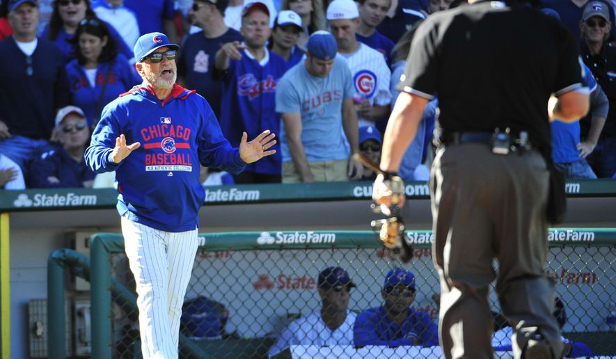 Chicago Cubs manager Joe Maddon, left, argues a call with home plate umpire Bruce Dreckman after a St. Louis Cardinals batter was hit by a pitch during the ninth inning of a baseball game, Saturday, Sept. 19, 2015, in Chicago. Madden was ejected from the game. The Cubs won 5-4. (AP Photo/David Banks)
