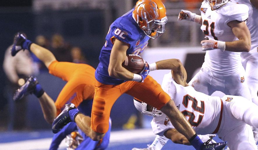 Boise State wide receiver Thomas Sperbeck heads upfield against Idaho State during the first half against Idaho State in an NCAA college football game Friday, Sept. 18, 2015, in Boise, Idaho. (Joe Jaszewski/The Idaho Statesman via AP)