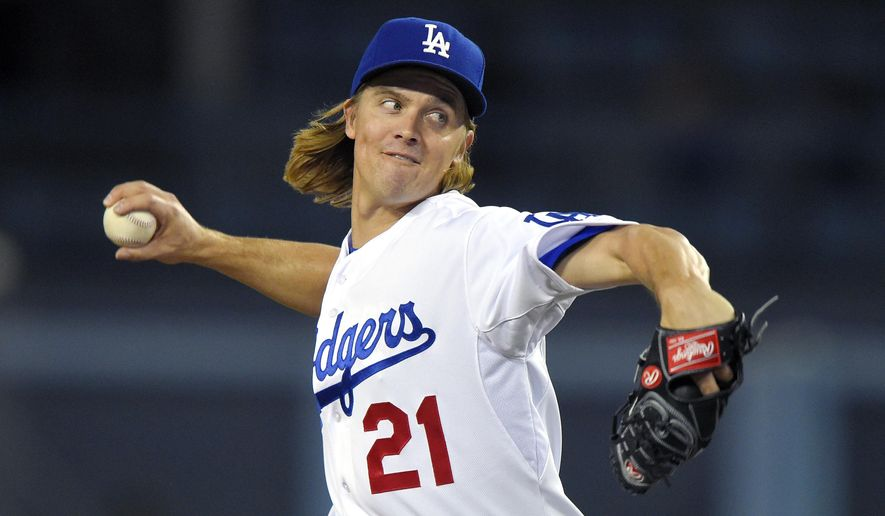 Los Angeles Dodgers starting pitcher Zack Greinke throws to the plate during the first inning of a baseball game against the Pittsburgh Pirates, Friday, Sept. 18, 2015, in Los Angeles. (AP Photo/Mark J. Terrill)