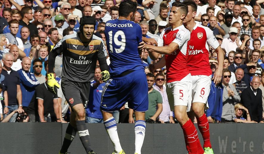 Arsenal's Gabriel, No 5, reacts and puts his arms onto Chelsea's Diego Costa, No 19, during the English Premier League soccer match between Chelsea and Arsenal at Stamford Bridge stadium in London, Saturday, Sept. 19, 2015. Both players were show a yellow card for the incident, with Gabriel being sent off for a further clash between the two player- Chelsea went onto win the game 2-0.(AP Photo/Alastair Grant)