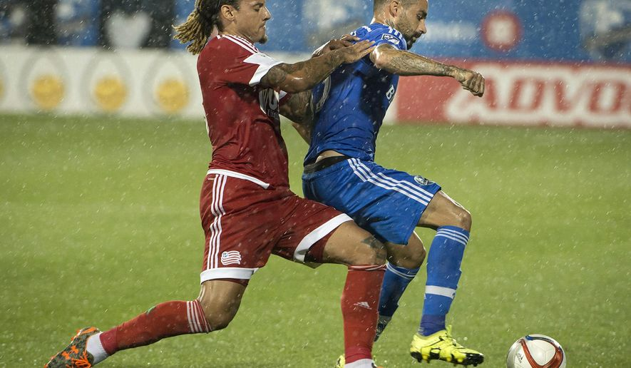 New England Revolution's Jermaine Jones, left, puts pressure on Montreal Impact's Andres Romero during the first half of an MLS soccer match Saturday, Sept. 19, 2015, in Montreal. (Peter McCabe/The Canadian Press via AP)