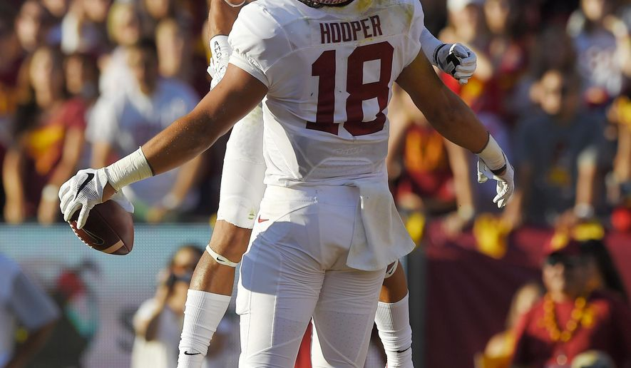 Stanford tight end Austin Hooper, below, celebrates along with wide receiver Michael Rector after scoring a touchdown during the first half of an NCAA college football game against Southern California, Saturday, Sept. 19, 2015, in Los Angeles. (AP Photo/Mark J. Terrill)