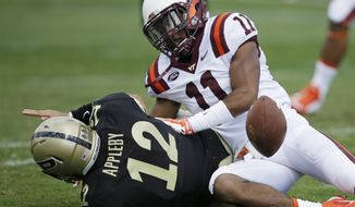 Purdue's Austin Appleby (12) fumbles after being tackled by Virginia Tech's Kendall Fuller (11) during the first half of an NCAA college football game Saturday, Sept. 19, 2015 in West Lafayette, Ind. (AP Photo/Darron Cummings)