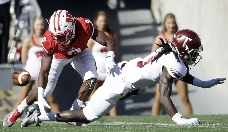 Wisconsin's Sojourn Shelton (8) breaks up a pass intended for Troy's Jarvis Bentley (3) during the first half of an NCAA college football game Saturday, Sept. 19, 2015, in Madison, Wis. (AP Photo/Morry Gash)