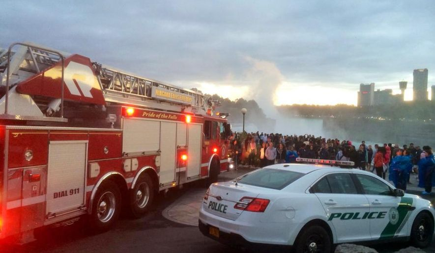 In this photo provided by WIVB, a crowd gathers near where someone reportedly went over the American Falls in Niagara Falls, N.Y., Saturday, Sept. 19, 2015. (WIVB via AP) MANDATORY CREDIT