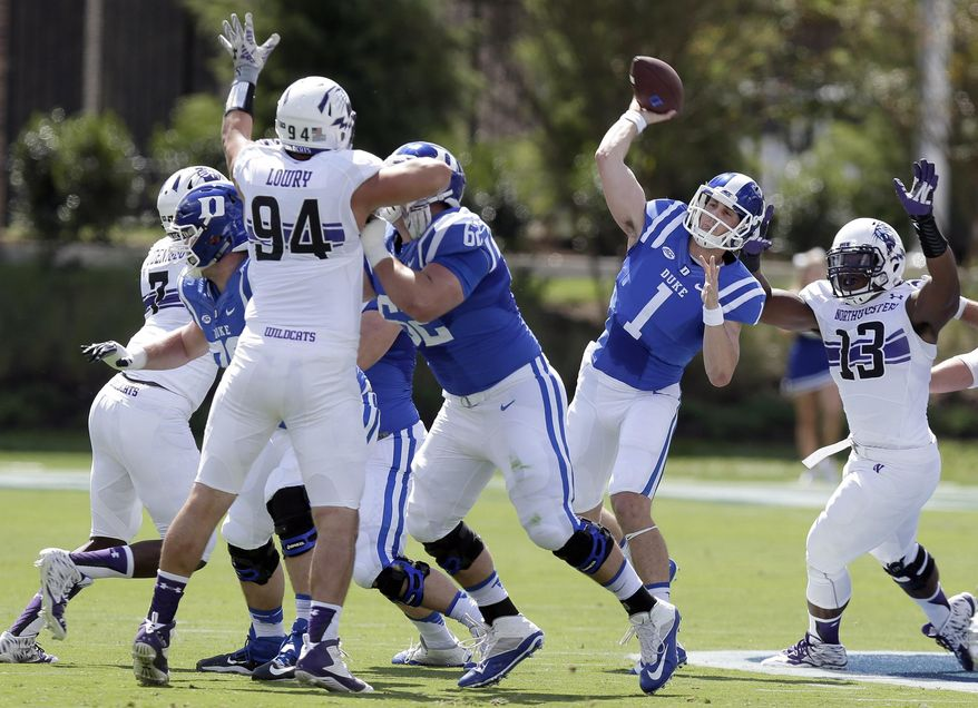 Duke quarterback Thomas Sirk (1) passes as Northwestern's Deonte Gibson (13) rushes and Dean Lowry (94) blocks during the first half of an NCAA college football game in Durham, N.C., Saturday, Sept. 19, 2015. (AP Photo/Gerry Broome)
