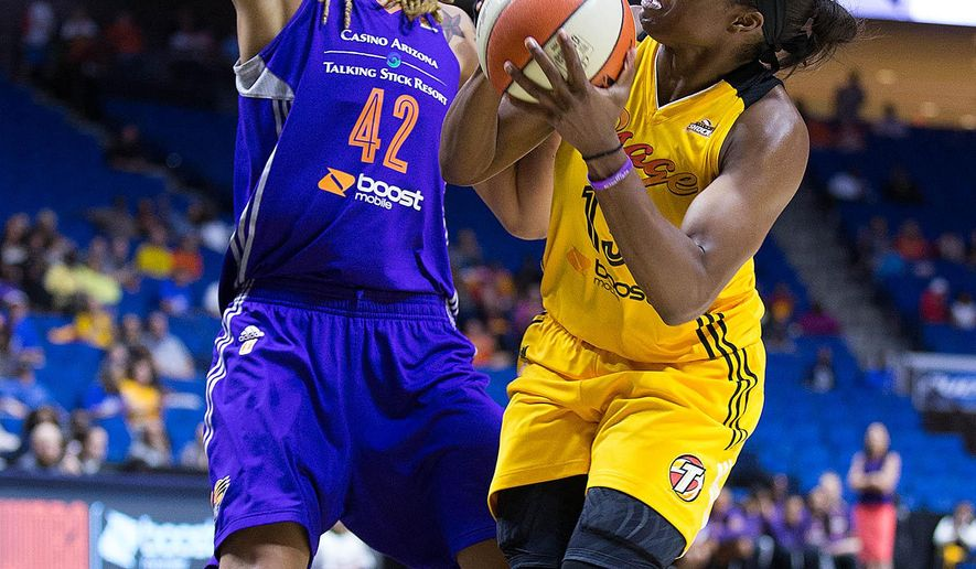 Tulsa Shock's Karima Christmas, right, drives the basket and is defended by Phoenix Mercury's Brittney Griner (42) during a WNBA Western Conference semifinal Saturday, Sept. 19, 2015, in Tulsa, Okla. (Joey Johnson/Tulsa World via AP) ONLINE OUT; KOTV OUT; KJRH OUT; KTUL OUT; KOKI OUT; KQCW OUT; KDOR OUT; TULSA OUT; TULSA ONLINE OUT; MANDATORY CREDIT