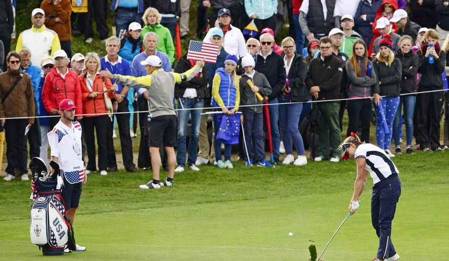 Lexi Thompson of United States hits the ball during the fourballs on Day2 at the Solheim Cup golf tournament in St. Leon-Rot, southern Germany, Saturday, Sept. 19, 2015. (AP Photo/Jens Meyer)