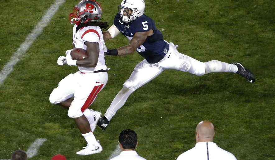 Penn State linebacker Nyeem Wartman-White (5) shoves Rutgers running back Josh Hicks out of bounds during the second half of an NCAA college football game in State College, Pa., Saturday, Sept. 19, 2015. Penn State won 28-3. (AP Photo/Gene J. Puskar)