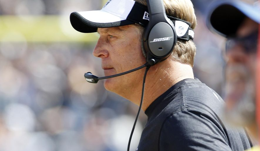 Oakland Raiders head coach Jack Del Rio watches from the sideline as his team plays the Baltimore Ravens during the second half of an NFL football game, Sunday, Sept. 20, 2015, in Oakland , Calif. (AP Photo/Tony Avelar)