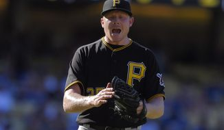Pittsburgh Pirates relief pitcher Mark Melancon celebrates as the Pirates defeated the Los Angeles Dodgers 4-3 in a baseball game, Sunday, Sept. 20, 2015, in Los Angeles. (AP Photo/Mark J. Terrill)