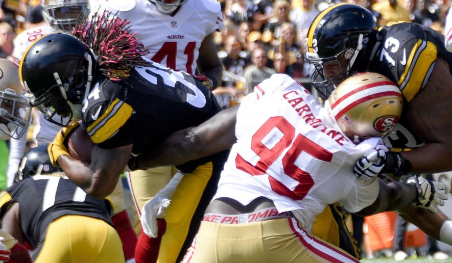 Pittsburgh Steelers running back DeAngelo Williams (34) scores a touchdown against the defense of San Francisco 49ers defensive tackle Tank Carradine (95) in an NFL football game, Sunday, Sept. 20, 2015, in Pittsburgh. (AP Photo/Don Wright)