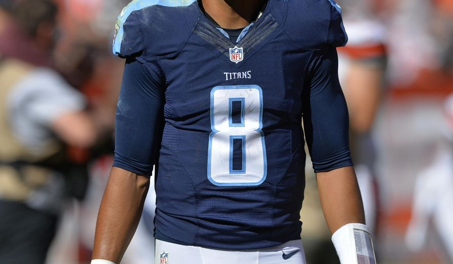 Tennessee Titans quarterback Marcus Mariota walks off the field after the Browns defeated the Titans 28-14 in an NFL football game Sunday, Sept. 20, 2015, in Cleveland. (AP Photo/David Richard)