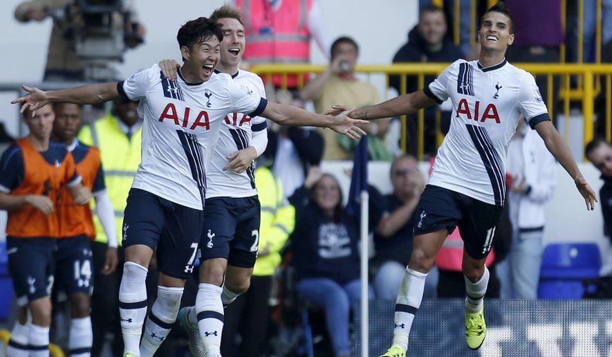 Tottenham Hotspur's Heung-Min Son, left, celebrates with Christian Eriksen and Erik Lamela, right, after scoring his side's first goal of the game against Crystal Palace  during their English Premier League match at White Hart Lane, London, Sunday Sept. 20, 2015. (Paul Harding/PA via AP) UNITED KINGDOM OUT