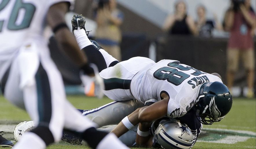 Philadelphia Eagles' Jordan Hicks (58) tackles Dallas Cowboys' Tony Romo (9) after a fumble during the second half of an NFL football game, Sunday, Sept. 20, 2015, in Philadelphia. (AP Photo/Matt Rourke)