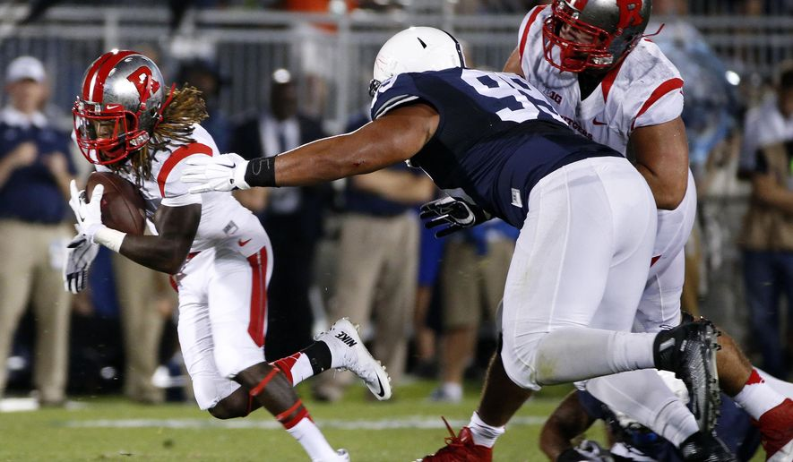 Rutgers wide receiver Janarion Grant, left, runs after catching a screen pass from quarterback Chris Laviano during the first half of an NCAA college football game against Penn State, Saturday, Sept. 19, 2015, in State College, Pa. (AP Photo/Gene J. Puskar)