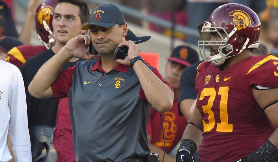Southern California coach Steve Sarkisian reacts to a penalty call as fullback Soma Vainuku watches during the first half of an NCAA college football game against Stanford, Saturday, Sept. 19, 2015, in Los Angeles. Stanford won 41-31. (AP Photo/Mark J. Terrill)