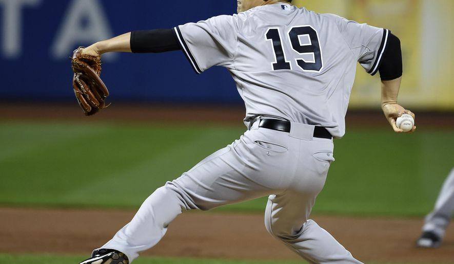 New York Yankees starter Masahiro Tanaka (19) pitches against the New York Mets in the first inning of a baseball game, Friday, Sept. 18, 2015, in New York. (AP Photo/Kathy Kmonicek)