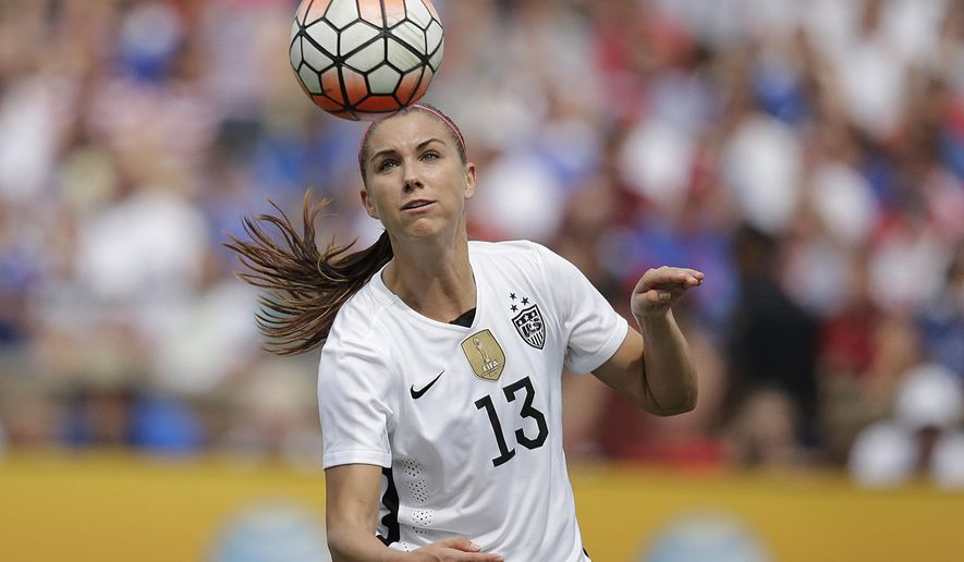 United States' Alex Morgan heads the ball agasint Haiti during the U.S. Women's World Cup victory tour, Sunday, Sept. 20, 2015, in Birmingham, Ala. (AP Photo/Brynn Anderson)