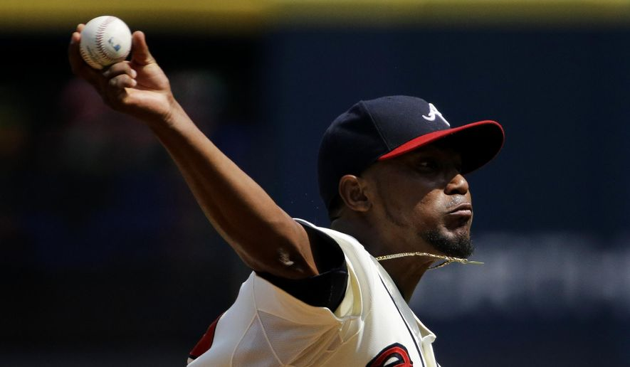 Atlanta Braves starting pitcher Julio Teheran throws in the first inning of a baseball game against the Philadelphia Phillies Sunday, Sept. 20, 2015, in Atlanta. (AP Photo/David Goldman)