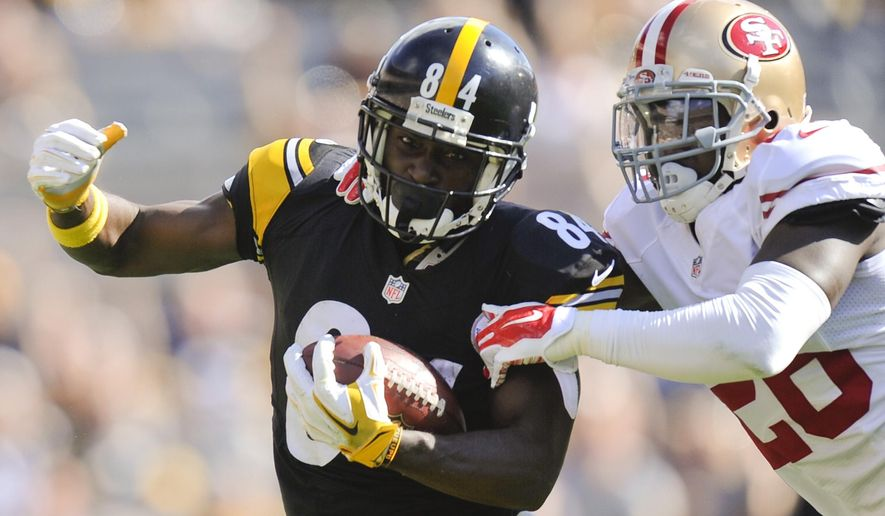 Pittsburgh Steelers wide receiver Antonio Brown (84) twists away from San Francisco 49ers cornerback Tramaine Brock (26) to go for a big gain after making a catch in the second quarter of an NFL football game, Sunday, Sept. 20, 2015, in Pittsburgh. (AP Photo/Don Wright)