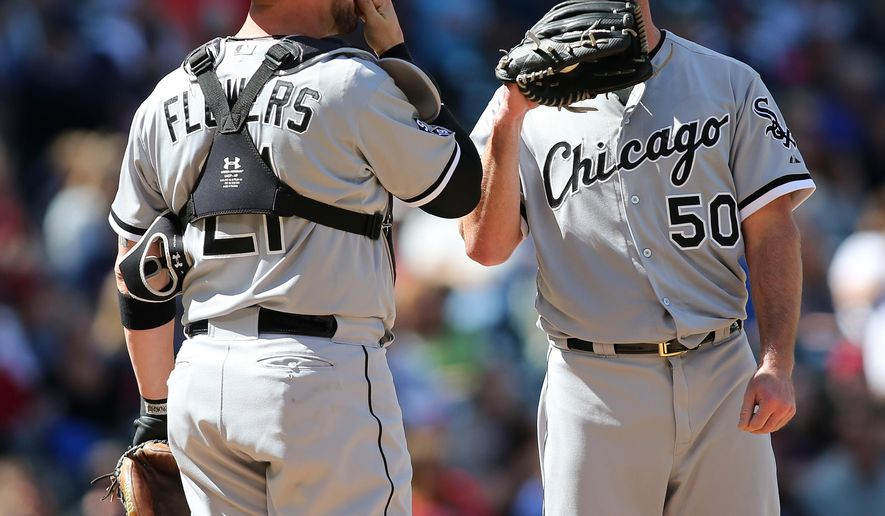 Chicago White Sox pitcher John Danks (50) talks with catcher Tyler Flowers during the second inning of a baseball game against the Cleveland Indians, Sunday, Sept. 20, 2015, in Cleveland. (AP Photo/Aaron Josefczyk)