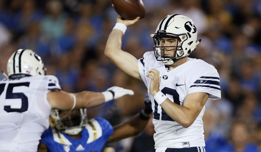 BYU quarterback Tanner Mangum passes the ball against UCLA during the first half of an NCAA college football game, Saturday, Sept. 19, 2015, in Pasadena, Calif. (AP Photo/Danny Moloshok)
