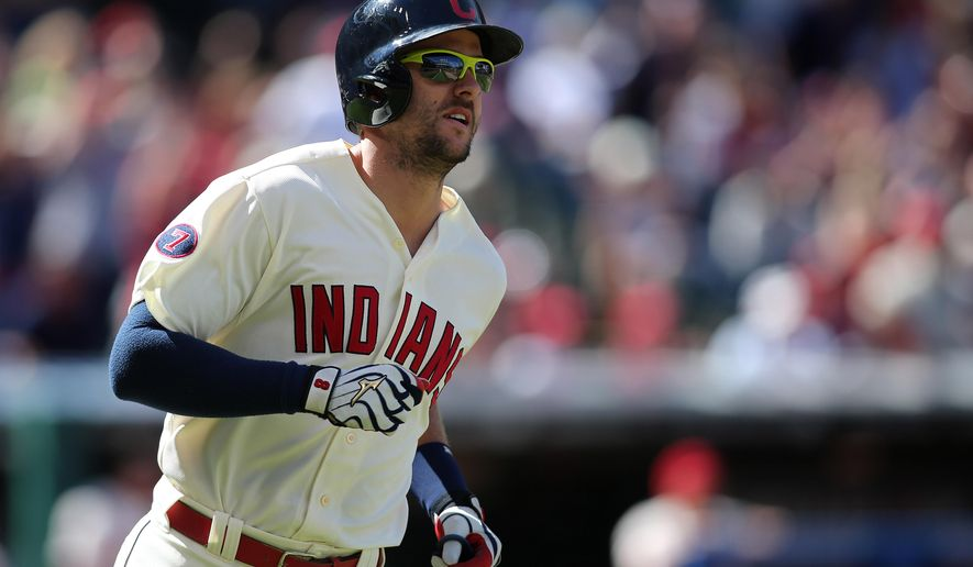 Cleveland Indians' Lonnie Chisenhall watches the ball leave the park for a two-run home run during the second inning of a baseball game against the Chicago White Sox, Sunday, Sept. 20, 2015, in Cleveland. (AP Photo/Aaron Josefczyk)