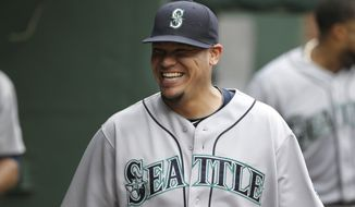 Seattle Mariners starting pitcher Felix Hernandez smiles in the dugout after the fifth inning of a baseball game against the Texas Rangers in Arlington, Texas, Sunday, Sept. 20, 2015. The Mariners won 9-2. (AP Photo/LM Otero)