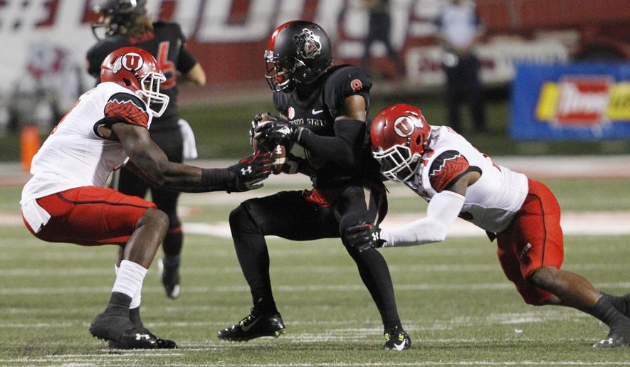 Utah linebacker Gionni Paul, right, defends against Fresno State wide receiver Da'Mari Scott during the first half of an NCAA college football game in Fresno, Calif., Saturday, Sept. 19, 2015. (AP Photo/Gary Kazanjian)