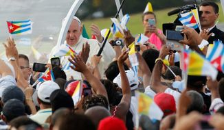 Pope Francis, who will address a joint session of Congress this week, arrives for Sunday Mass before hundreds of thousands of people in Havana, Cuba. (Associated Press)