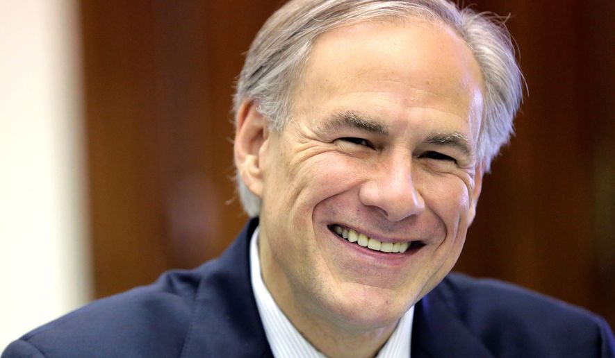 Texas Gov. Greg Abbott shares a laugh with news reporters during a round table talk in his office at the Texas Capitol, Wednesday, June 3, 2015, in Austin, Texas. (AP Photo/Eric Gay) ** FILE **